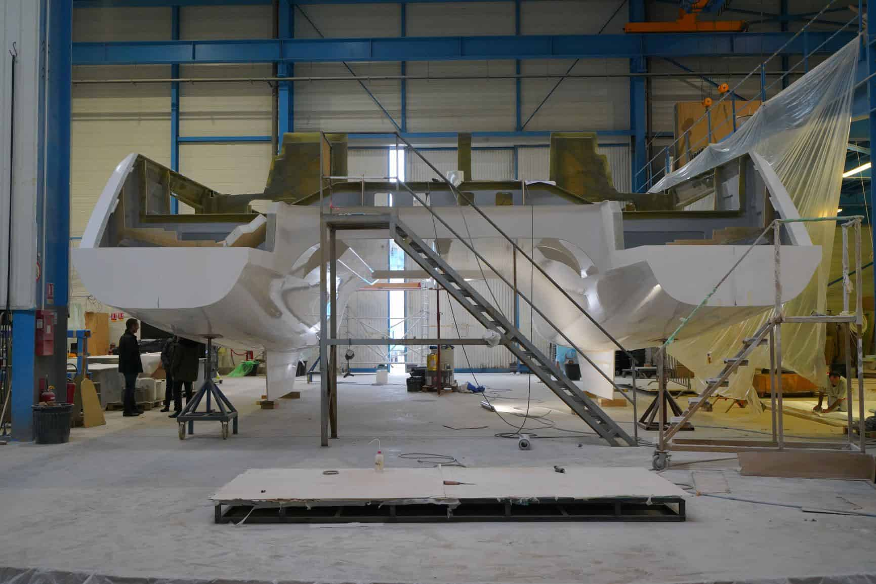 Bulkheads are installed before the hull is removed from the mold to ensure exact shape